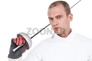 Close-up of swordsman holding fencing sword