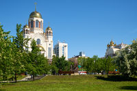 Blooming park in Yekaterinburg, with views of the Church on Blood in Honor of All Saints Resplendent in the Russian Land.