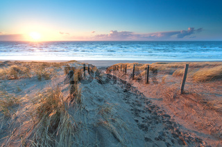 sunshine over the sand path to North sea coast