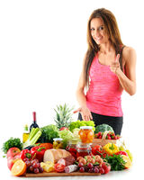 Young woman with assorted organic food products. Balanced diet