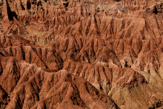 Drought red orange sand stone rock formation in Tatacoa desert, Huila