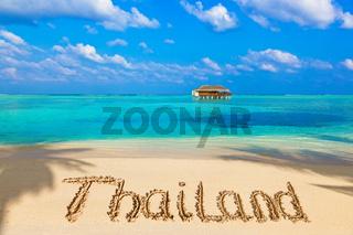 Word Thailand on beach