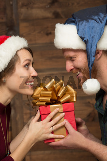 Close-up of happy couple holding present