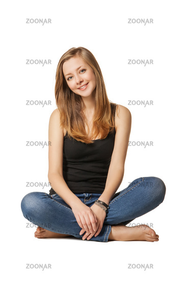 Attractive girl sitting on floor over white