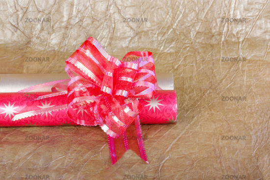 Beautiful red bow for gift decoration on gold background