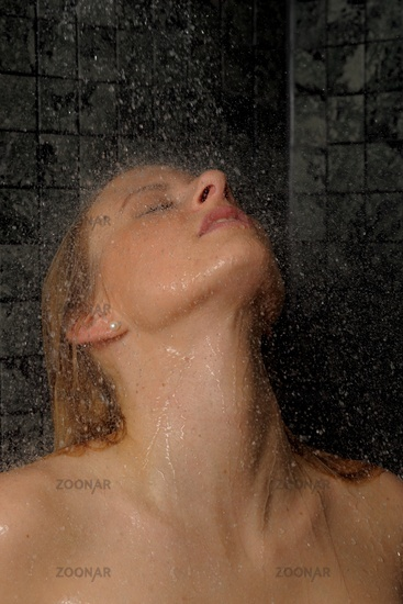 Young woman having a shower