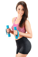 Young woman with dumbbells. Physical fitness.