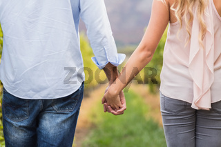 Young happy couple holding hands