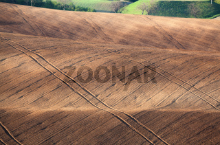 Landscape with striped fields of South Moravia at sunset. Background