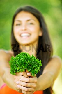 portrait cheerful woman hands herbs