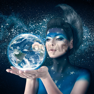 Moon woman holding planet earth