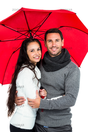Smiling couple under umbrella