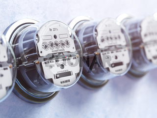 Row of analog electric meters. Electricity consumption concept.