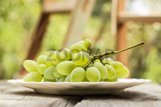 bunch of green grapes on white plate