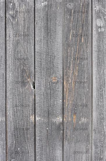 Graue alte Holzwand