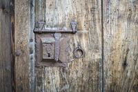 Old door lock on a wooden door