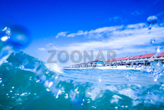 blue crystal water waves crashing on beach