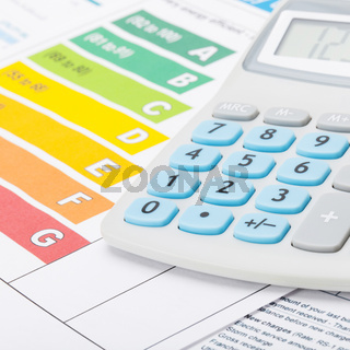 Energy efficiency chart with calculator - studio shot