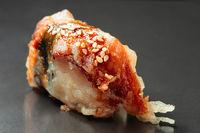 Sushi of fryed tuna, hot sushi roll macro