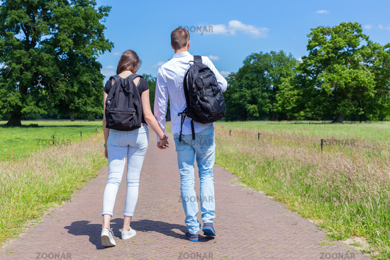 Young couple walking hand in hand in nature