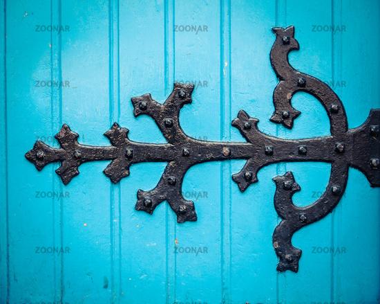 Ornate Hinge On Blue Church Door
