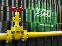 Oil pipe line valve in front of the Saudi Arabia flag on the oil barrels.  Gas and oil fuel energy concept.