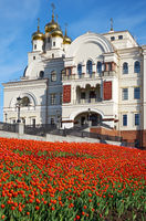 View of the Temple in the name of St. Nicholas in spring with blooming tulips in the foreground. Ekaterinburg