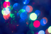 Christmas Background.  Holiday glowing Abstract Defocused Background With Blinking Lights. Blurred Bokeh. Retro Color Vintage toned photo