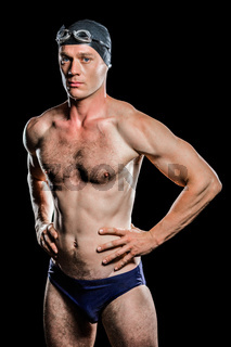 Swimmer standing with hand on hip