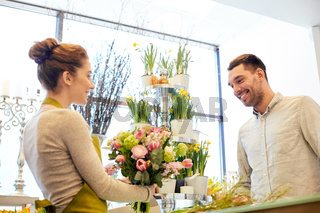 smiling florist woman and man at flower shop