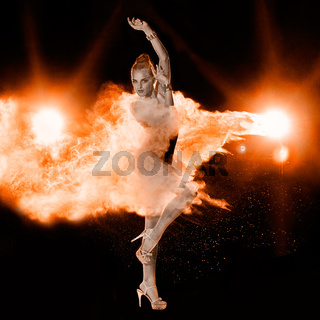 Young woman jumping in red powder cloud