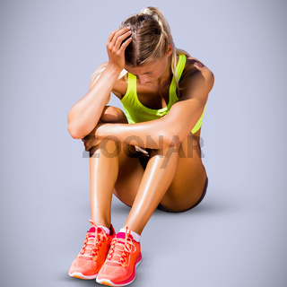 Composite image of sporty woman sitting down and feeling disappointed