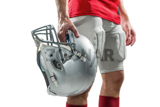 Close-up of American football player in red jersey holding helmet