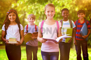 Composite image of smiling little school kids in school corridor