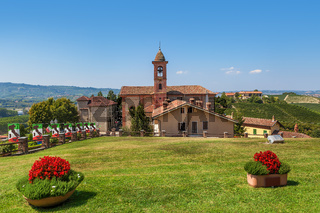 Green lawn and red church in Piedmont, Italy.