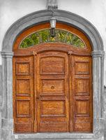 Asolid wooden hand carved timber door