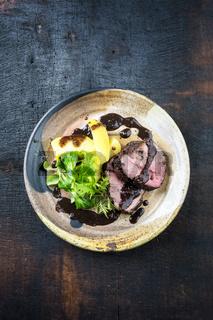 Roast Boar Steak with potato and Salad