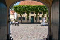 Looking through an archway onto the market square