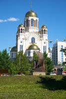 Blooming park in Yekaterinburg, with views of the Church on Blood in Honor of All Saints Resplendent in the Russian Land. monument to St. Prince Peter and Princess Fevronia