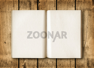 Open book on a brown wood table