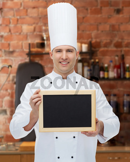 happy male chef cook holding blank menu board