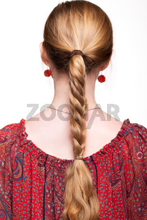 Studio portrait of young woman from back side