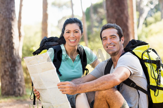 Couple smiling and holding a map