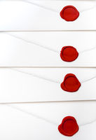 group of white letters with red sealing wax