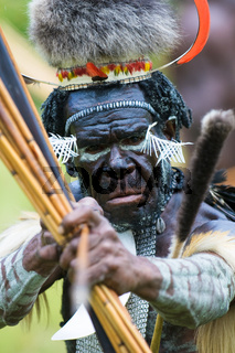 WAMENA, PAPUA, INDONESIA - November, 14: Yali Mabel, the chief of Dani tribe performing traditional fighting dance on November, 14, 2008 near Wamena, Papua, Indonesia.