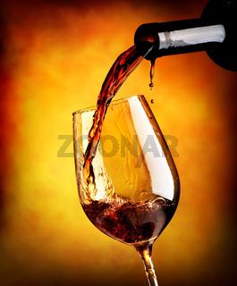 Red wine on orange background