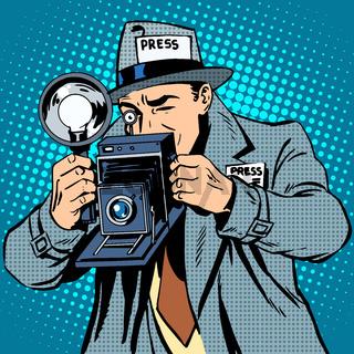 Photographer paparazzi at work press media camera