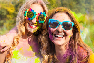 Happy young girls on holi color festival