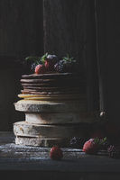 Breakfast in the wood : chocolate pancakes with strawberries and blackberries