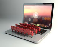 Video player app or home cinema concept. Laptop and rows of cinema seats,